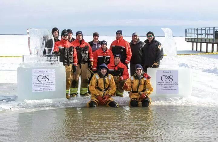 The departments Ice Team poses on the ice